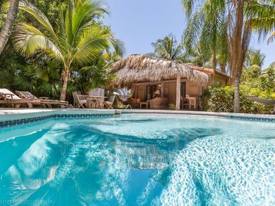 Photo for Tropical oasis: private heated pool & spa, 5 minutes drive to beach & shops.