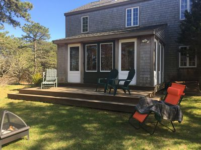 back deck with large yard
