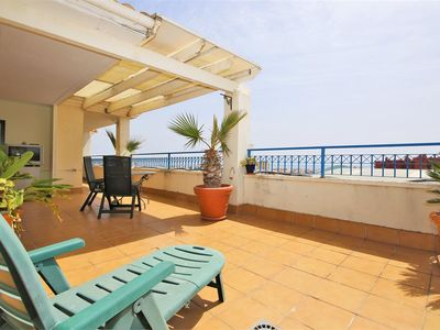Photo for Central apartment with WIFI and garden terrace, 750 m to Estepona port, close to restaurants