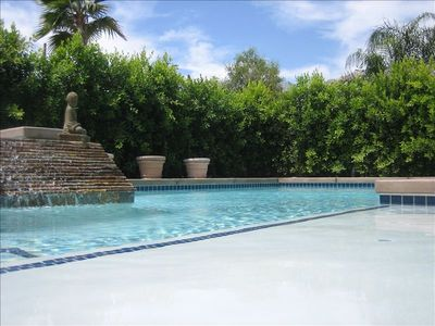 private pool with tanning shelf, spa, waterfall and fountains