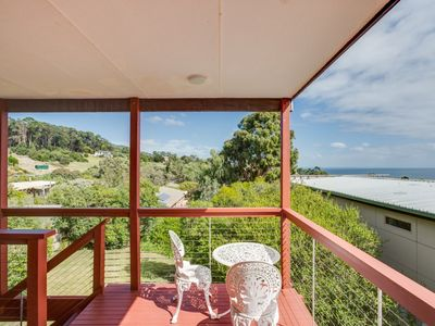 Photo for Original beach cottage is set high on the hill offering views across the bay