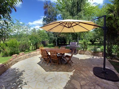Gorgeous back yard with huge patio for al fresco dining, entertaining & grilling