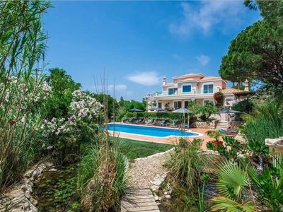 Photo for Stunning luxury villa in Quinta do Lago with private pool and sea views. DM02