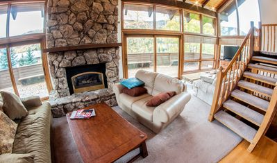 Living Room - Large vaulted ceilings and huge bay windows offer exceptional natural light