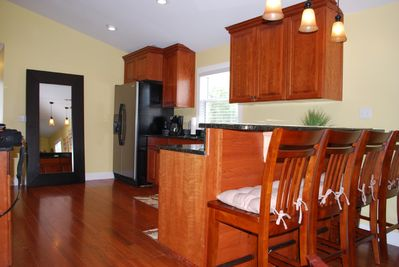 Kitchen- with granite, built in ice maker,smooth top stove,microwave,& disposal