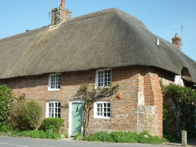 Photo for Cosy thatched cottage minutes from the sea, nestled in gentle rural countryside