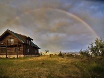 Green Off the Grid log cabin in Beautiful Star Valley on 320 acres