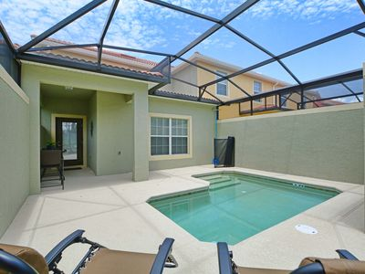 Photo for MINUTES TO DISNEY, PROFESSIONALLY DECORATED, GATED RESORT COMMUNITY, FREE WIFI!!!