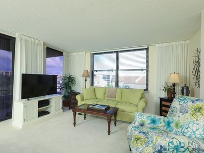 Photo for Beach Access, Pool, Boat Dock, Wrap Around Balconies, Gym, Green Spaces!