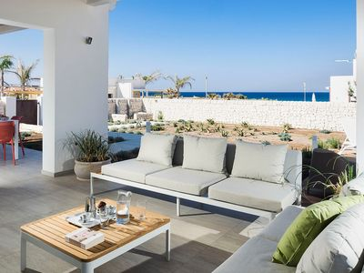 Photo for Three villas next to each other, sea front with private pools