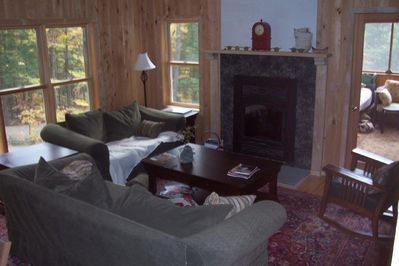 Living area with working fireplace.