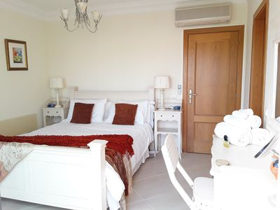 Large Master bedroom, with private sun terrace, fitted comfy seats & sunbeds