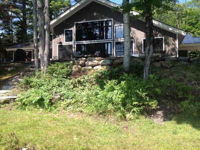 Photo for Gorgeous lakefront home on private wooded lot, close to Stowe and Jay Peak