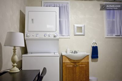 Laundry/bath at one bedroom house.