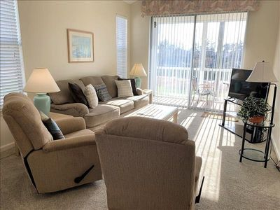 Photo for Bright and airy 3rd floor condo with full size washer/dyer!