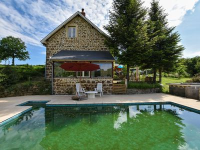 Photo for Appartment in converted country house with natural swimming pool