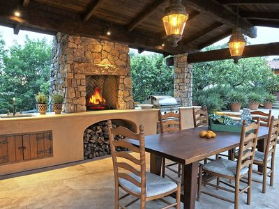 Shaded outdoor kitchen has all you need to create an unforgettable dining experience