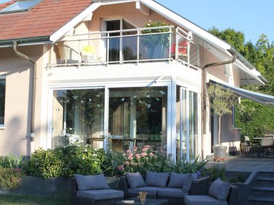 Photo for Contemporary villa on Lake Leman with pool, private access and pontoon
