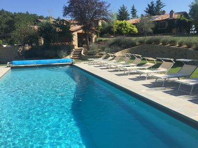 14m pool situated just below the pool house and outdoor kitchen