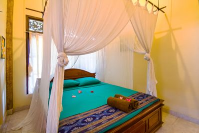 Double Bed with mosquito net .completely with air con