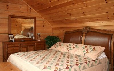 Upper level master bedroom with king bed