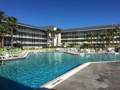 Photo for CLOSE TO ATTRACTIONS! TWO COMFY UNITS FOR 8 GUESTS, POOL, TIKI BAR, SHUTTLE