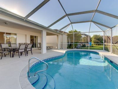 Photo for Charming home w/ a screened-in pool set on five acres with two lakes!