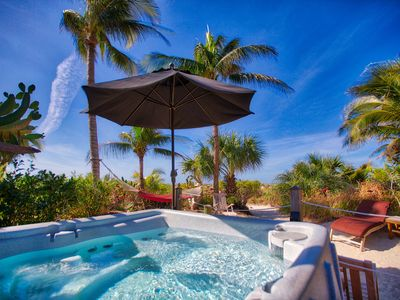 Photo for Coquina Cottage ON the Beach - BEACH GARDEN SUITE - pet friendly, grill, jacuzzi