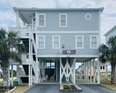 """Photo for Relax and enjoy being """"Sunkissed by the Sea"""". Located on the quiet east end of Holden Beach, this home offers spectacular views of the ocean, dunes and inlet."""