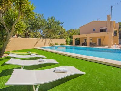 Photo for 7 bedroom Villa, sleeps 14 with Pool and Walk to Beach & Shops