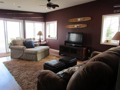 Off the Kitchen is the open area for relaxing, movies, or enjoying the lake view