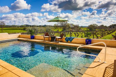 Swim in the private pool with rolling vineyards as the backdrop.
