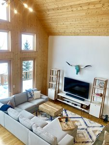 Living room with 66-inch tv and large cozy couch