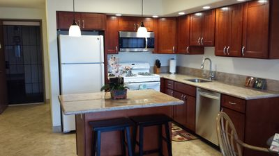 Photo for Beautiful Condo with ocean view.  Steps from the beach!!