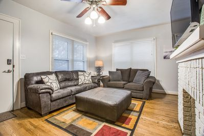 A cozy living room with comfortable couches along with a large Smart TV.