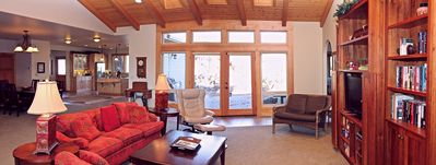 Pan photo of living area dining and kitchen.  Lots of space! View to patio.