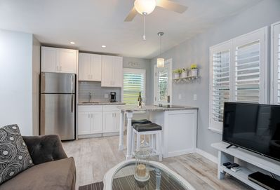 Living area opens to beautiful kitchen w/full size fridge, lots of cabinet space