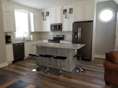 Kitchen with bar stools, stainless steel appliances