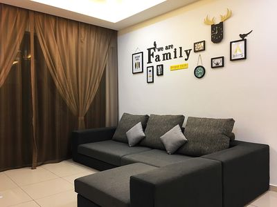 The living room is charming with lovely decorations - We are family.