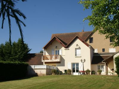 Photo for Fine holiday home with swimming pool on idyllic estate in Faverolles-en-Berry
