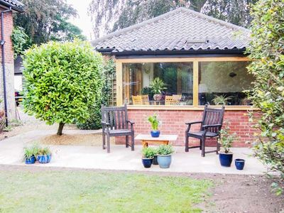 Photo for THE LODGE, romantic, with hot tub in Coltishall, Ref 938383