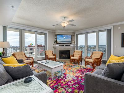 Photo for Enjoy a large, spacious designer unit with all the extras plus an indoor pool, outdoor pool, fitness room, assigned parking and shops on the ground level.