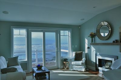 The inviting living room with balcony, gas fireplace, and more.