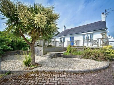 Photo for Beautifully styled and decorated with nautical touches, this delightful bungalow provides excellent