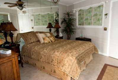 Seaside Villa # 373 Bedroom - Beautifully decorated bedroom features a Queen Bed, two nightstands with reading lamps.