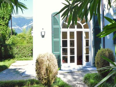 Photo for Apartment with private garden in the Italian style, a few steps from the lake.