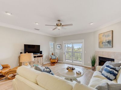 Photo for NEW LISTING! Steps to the beach! Private screened balcony! Clean and maintained!