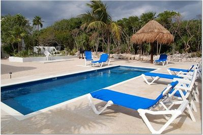 The pool and palapas await you.