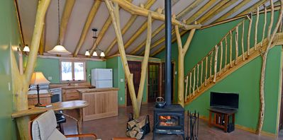 Relax by the wood stove fire and enjoy the huge picture windows.