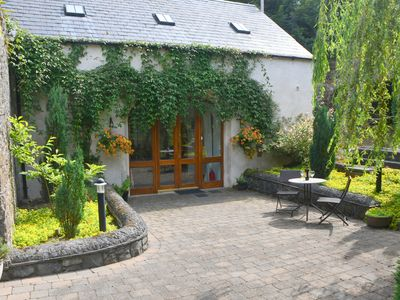 Photo for Beautifully Restored Coach House In Woodlands Overlooking The Suir Estuary